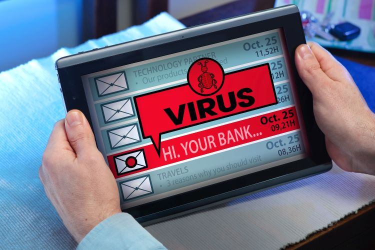 hands of a man looking inbox in tablet with a virus message / man with tablet which see emails and alert message with the word virus