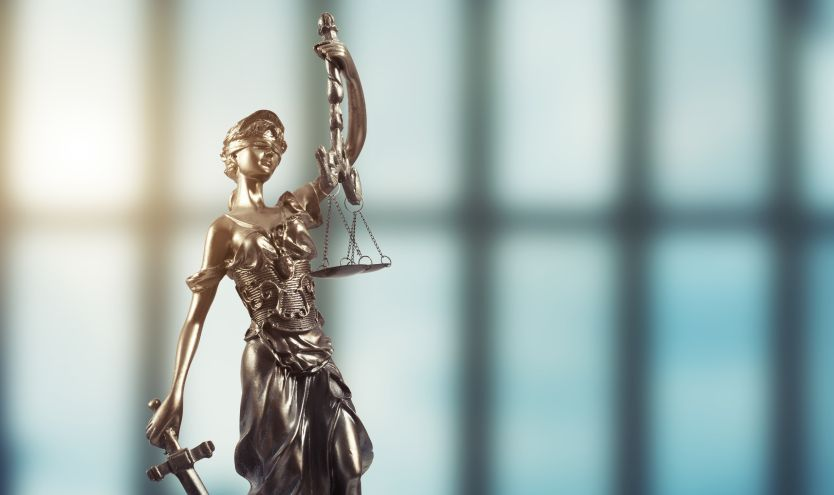 Lady Justice holding a sword and the scales of justice