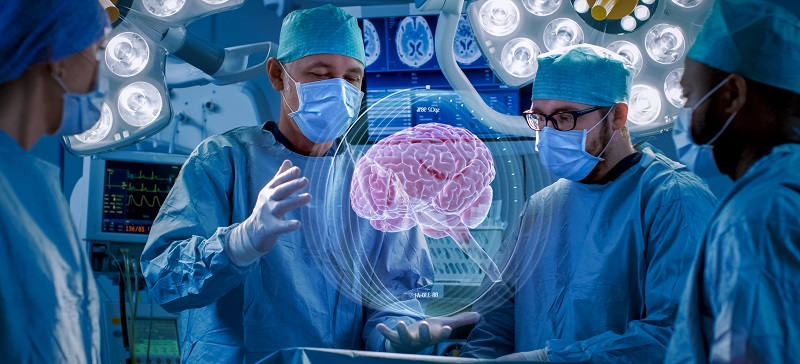 Surgeons teaching brain surgery to medical students